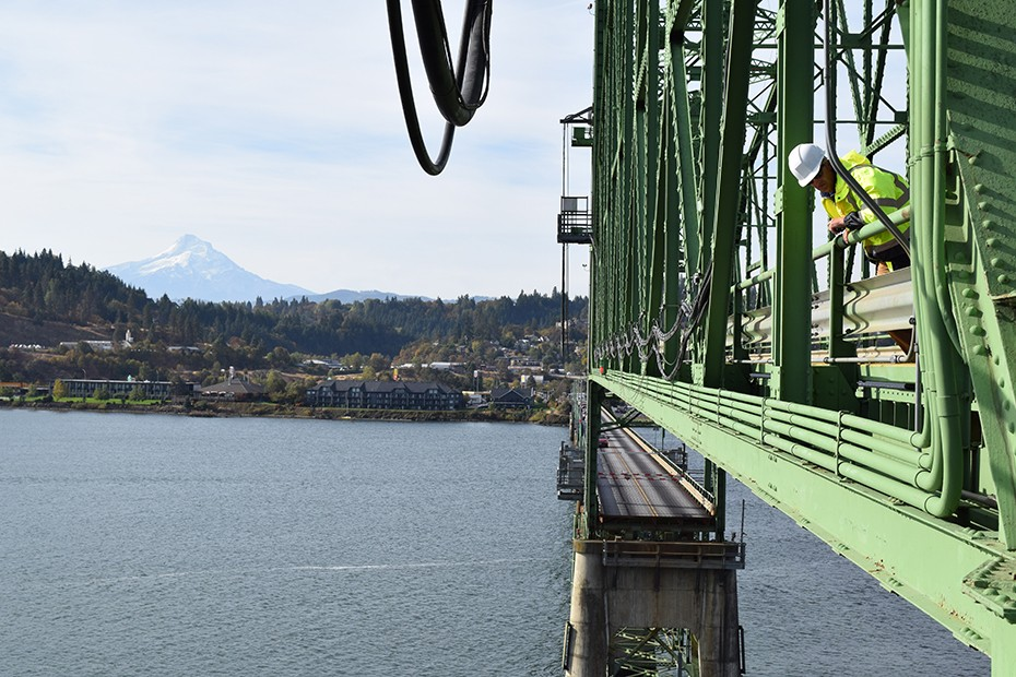 Port photo. Port crews inspect the lift span during a lift 2015.