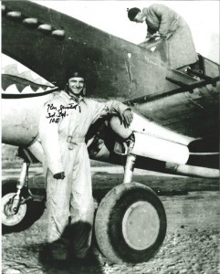 Photo credit: Hood River News. Flying Tiger Ken Jernstedt stands next to his plane during World War II.
